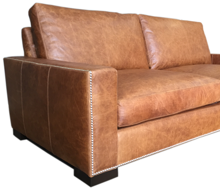 Custom application of nail head trim for your leather furniture