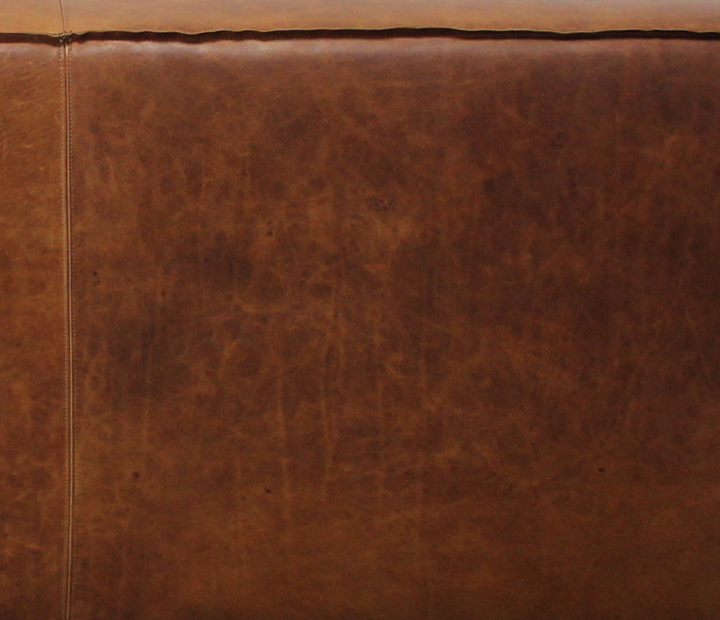 Full Grain, Aniline Leather is not corrected, meaning that scars and natural markings are not corrected or sanded away as with Corrected Top Grain leather