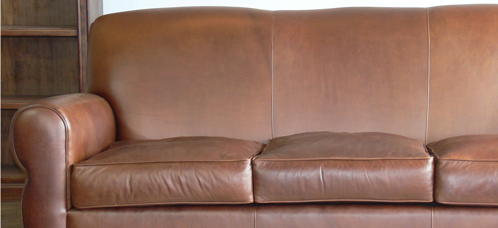 The Midtown Leather Furniture Collection, shown in Captains Choice Chocolate
